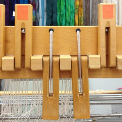 levers on a table loom